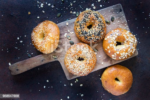 Bagels on old cutting board.