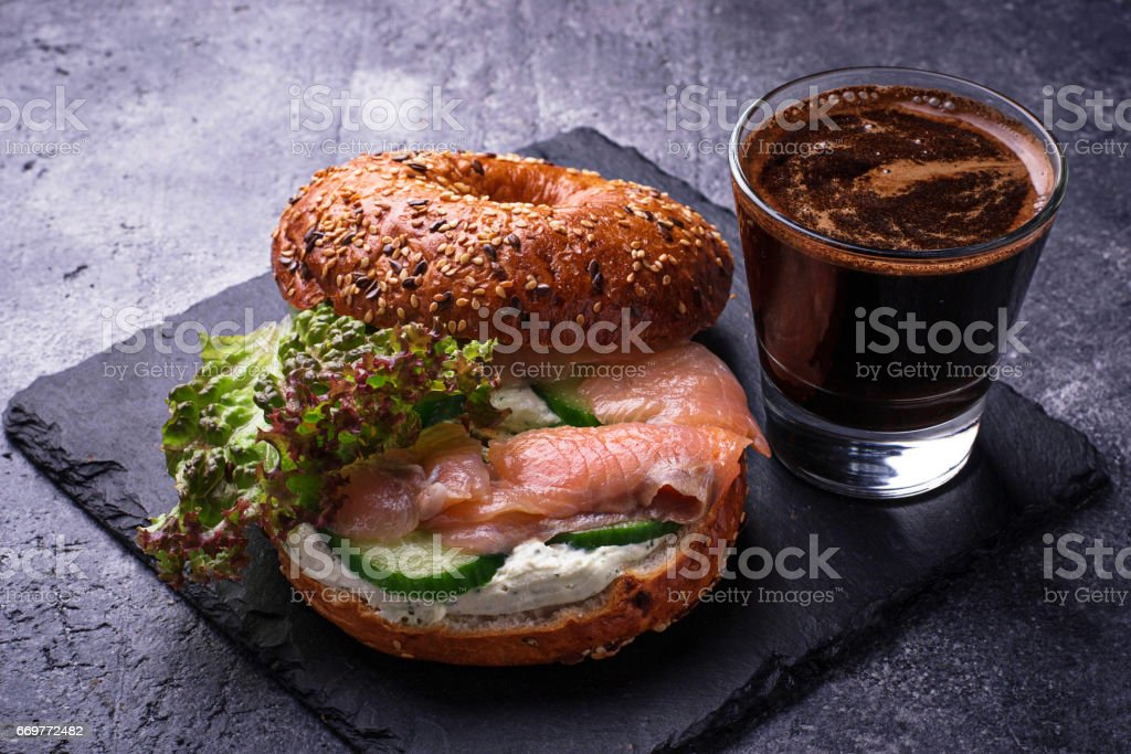Bagels with salmon, cream cheese and lettuce stock photo