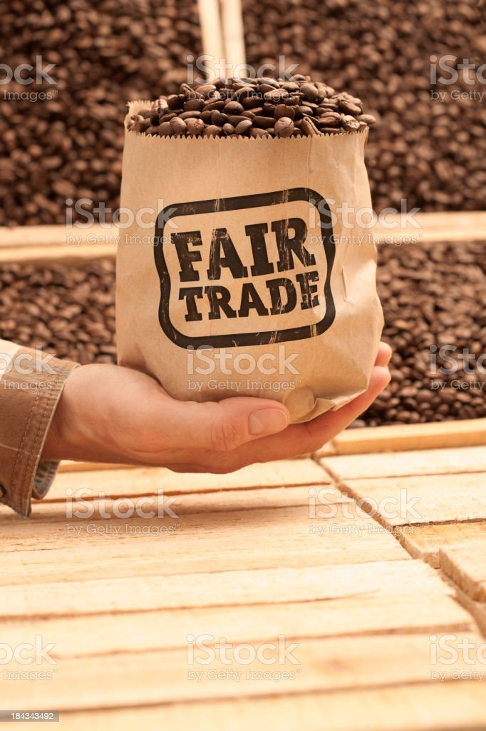 Bagful of FAIR TRADE coffee beans royalty-free stock photo