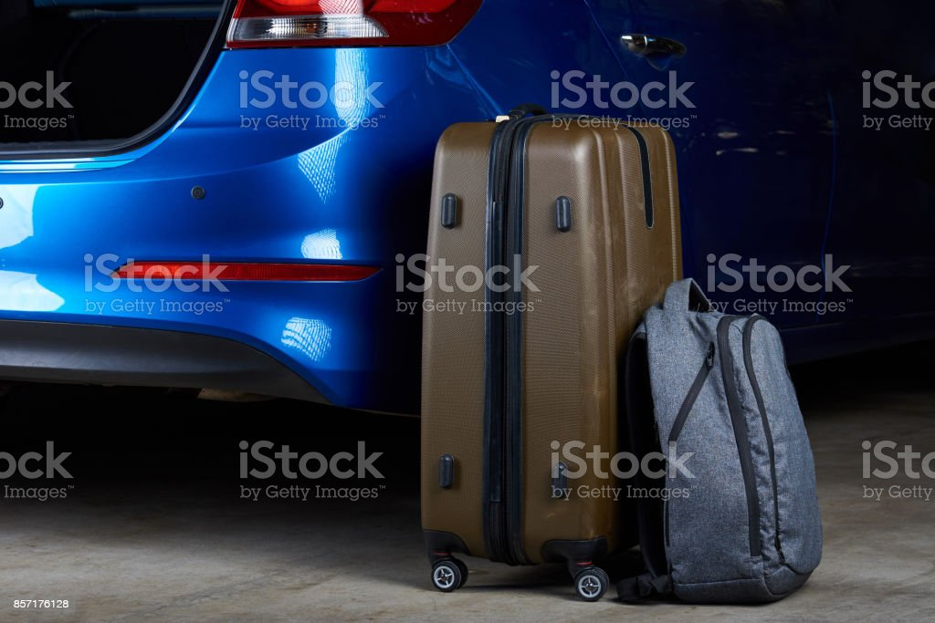 Baggage bags loading to car trunk stock photo