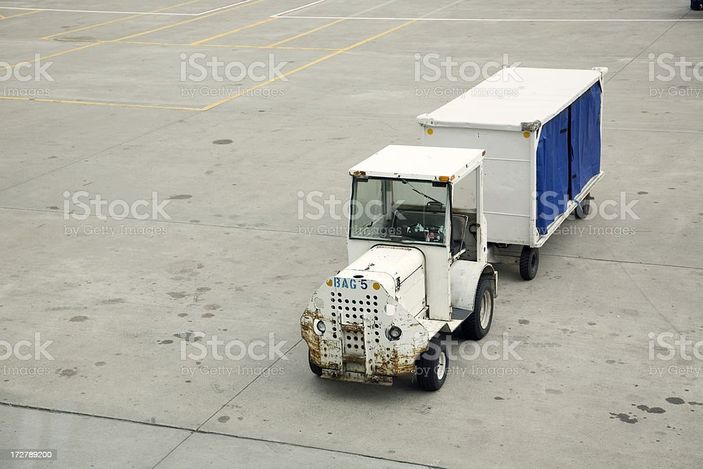 Baggage Cart on Airport Deck royalty-free stock photo