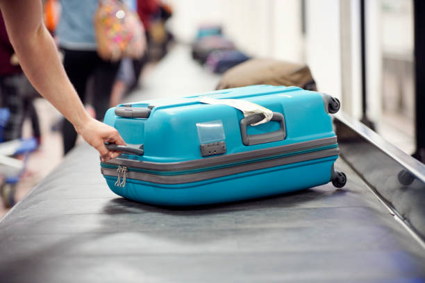 Baggage claim luggage conveyor belt at airport stock photo