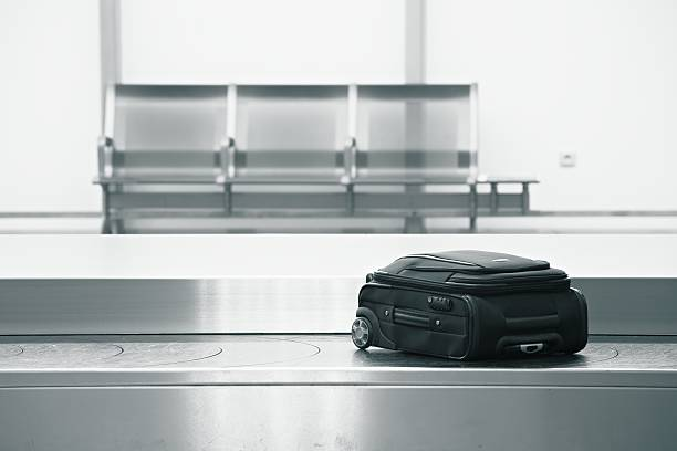 baggage claim - conveyor belt stock pictures, royalty-free photos & images
