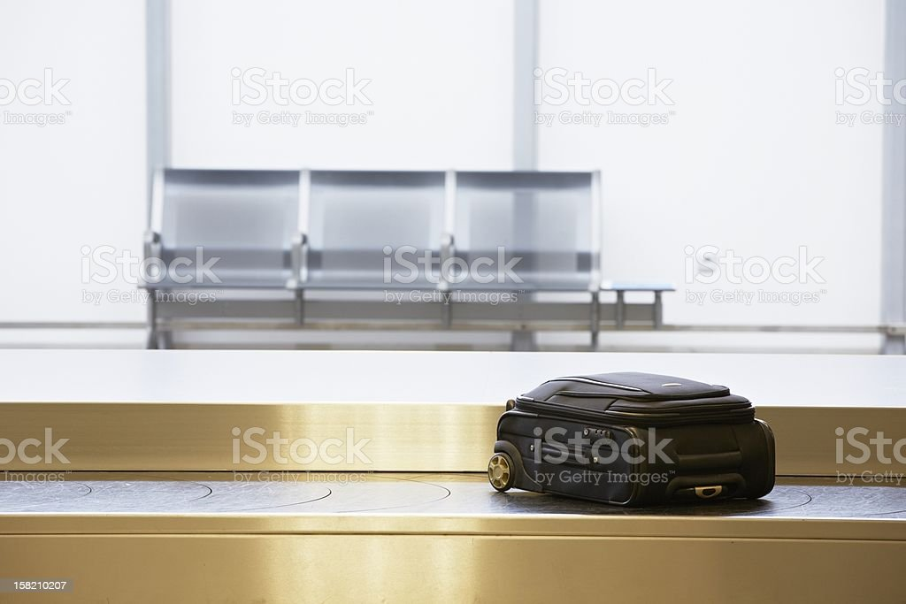 Baggage claim with one suitcase at an airport stock photo