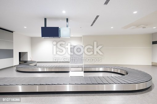 istock Baggage conveyor belt in airport 910718086