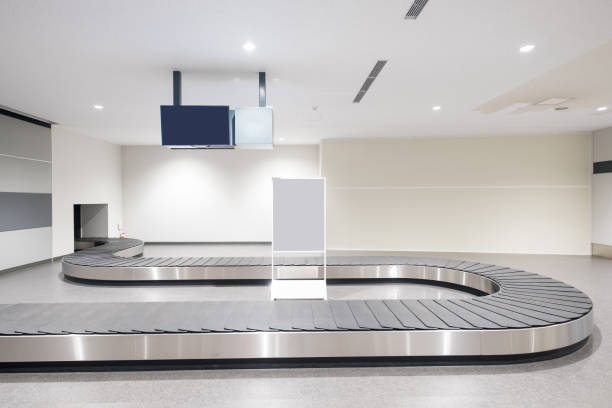 baggage conveyor belt in airport - conveyor belt stock pictures, royalty-free photos & images