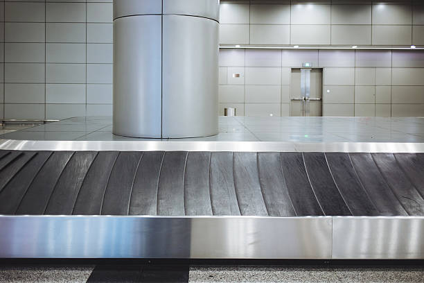 Baggage conveyor belt in the airport stock photo