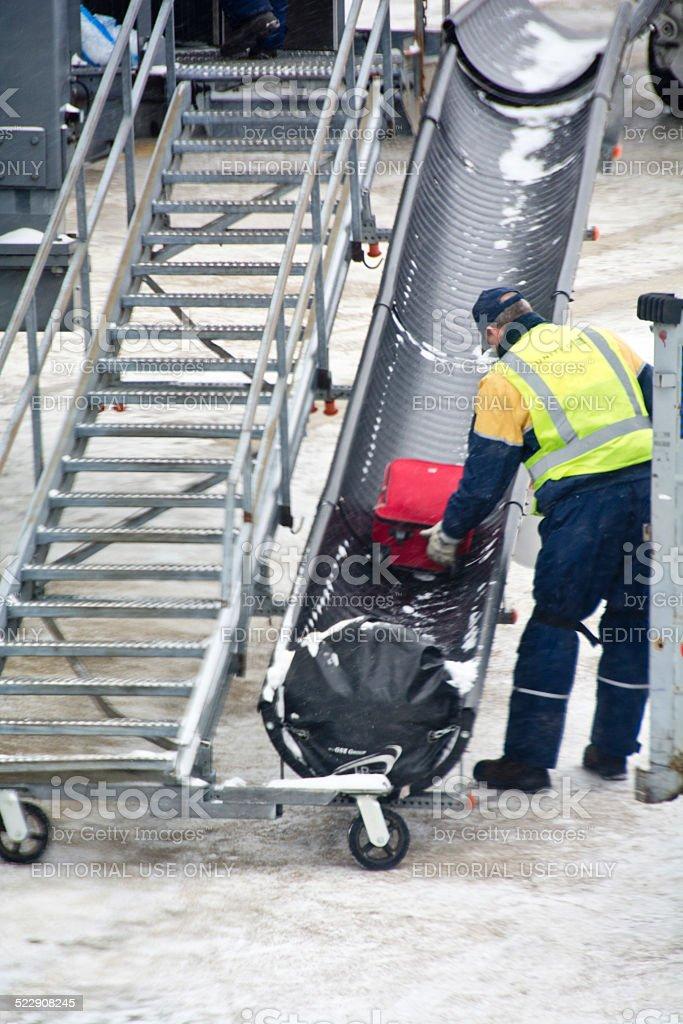 Baggage handler at a ramp stock photo