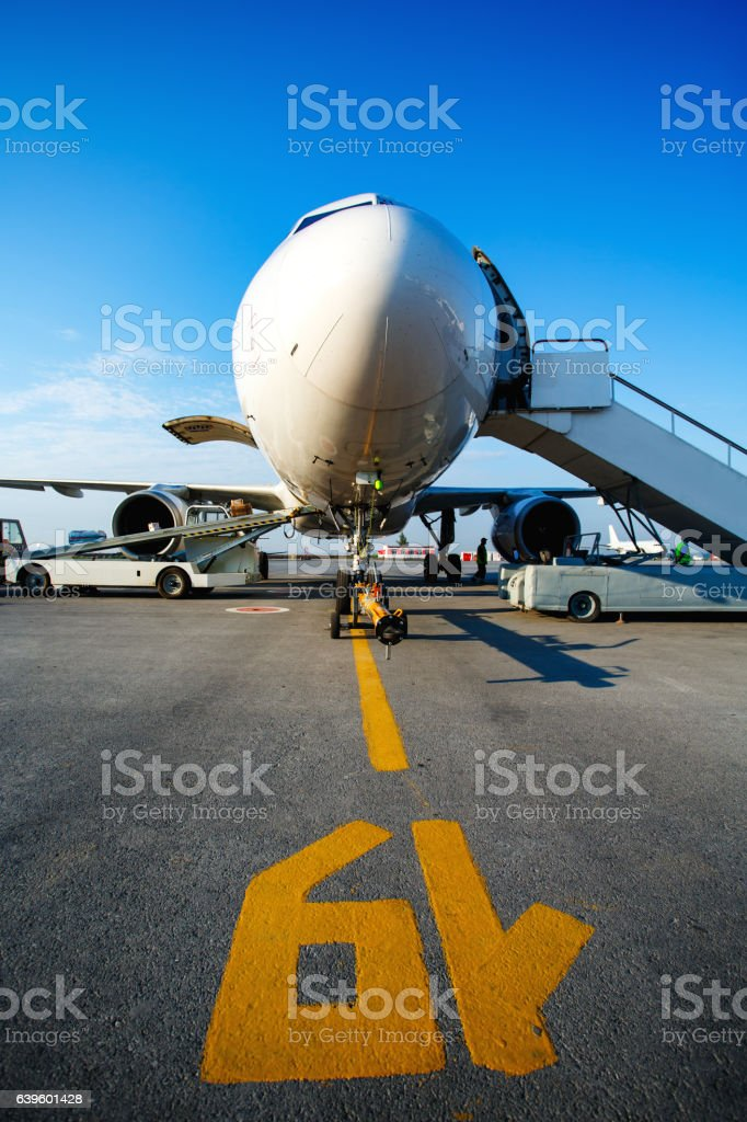 Baggage is loading into of the aircraft stock photo