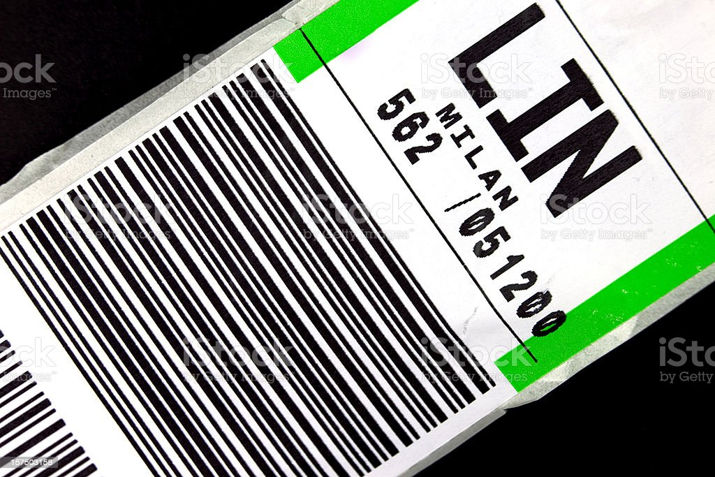 Baggage label for a flight to Milan stock photo