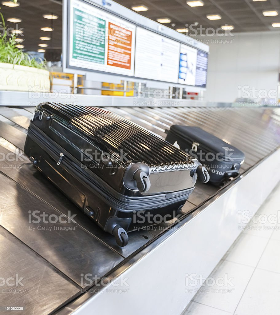 Baggage on conveyor belt at the airport stock photo