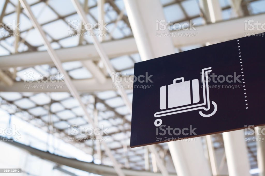 baggage sign in airport stock photo