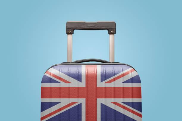 Equipaje con bandera del Reino Unido imprimir turismo y concepto de vacaciones. - foto de stock