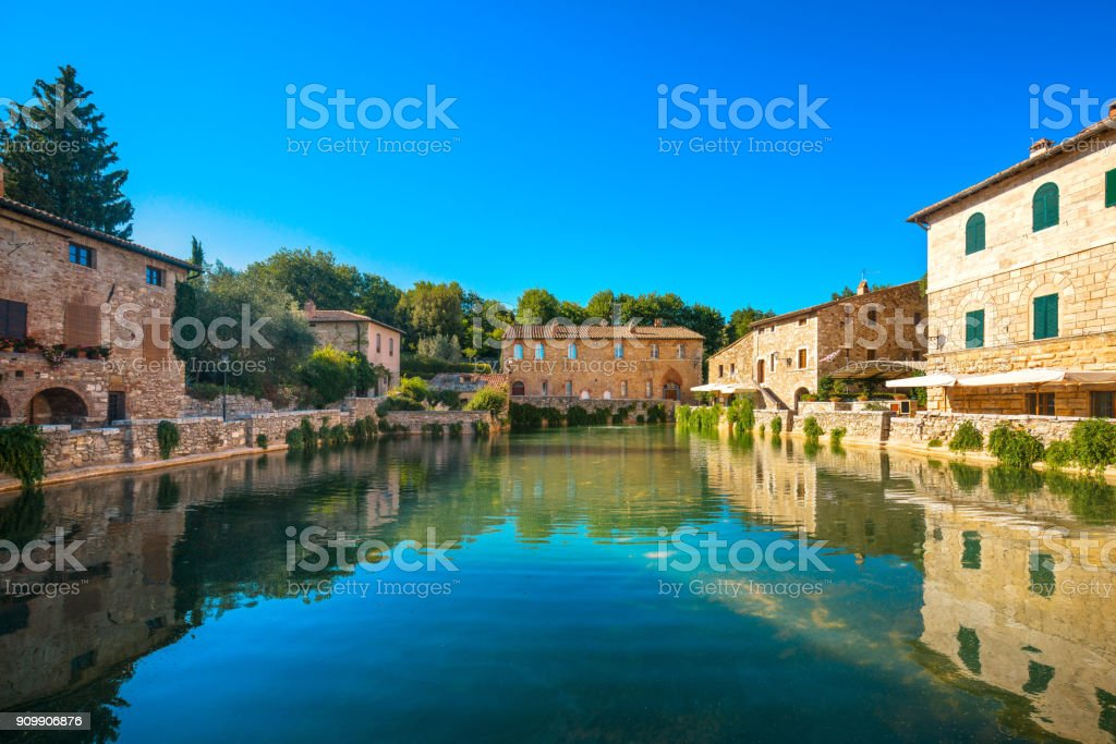 Bagno Vignoni village medieval thermal baths or hot pool. Tuscany, Italy. stock photo