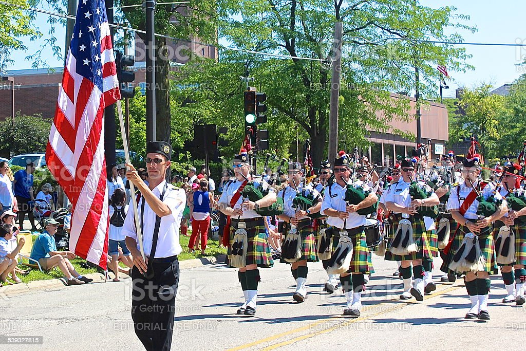 Bagpipe band marching in Independence Day 4th of July Parade. stock photo