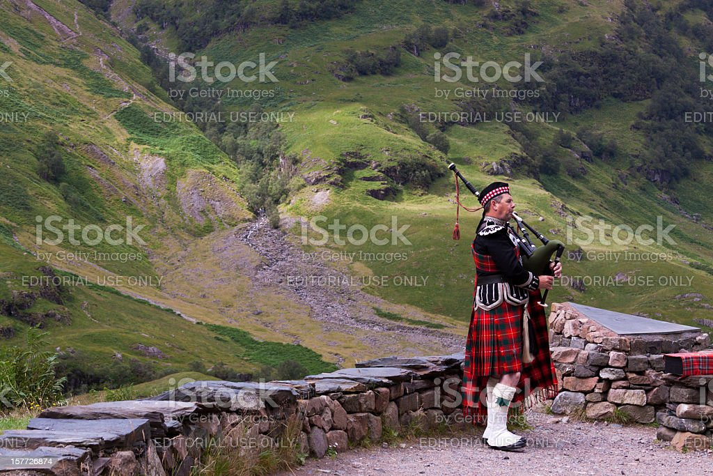 Bagpiper in Glencoe. stock photo