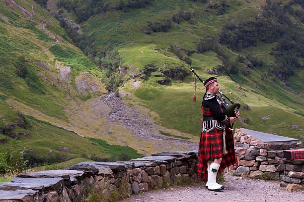 Bagpiper in Glencoe. stock photo