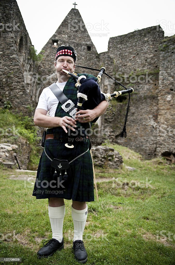 Bagpiper in old Ruins stock photo