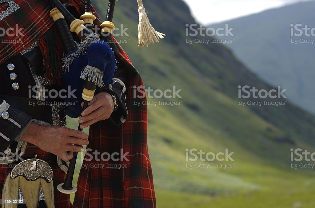 BagPiper in Scotland stock photo