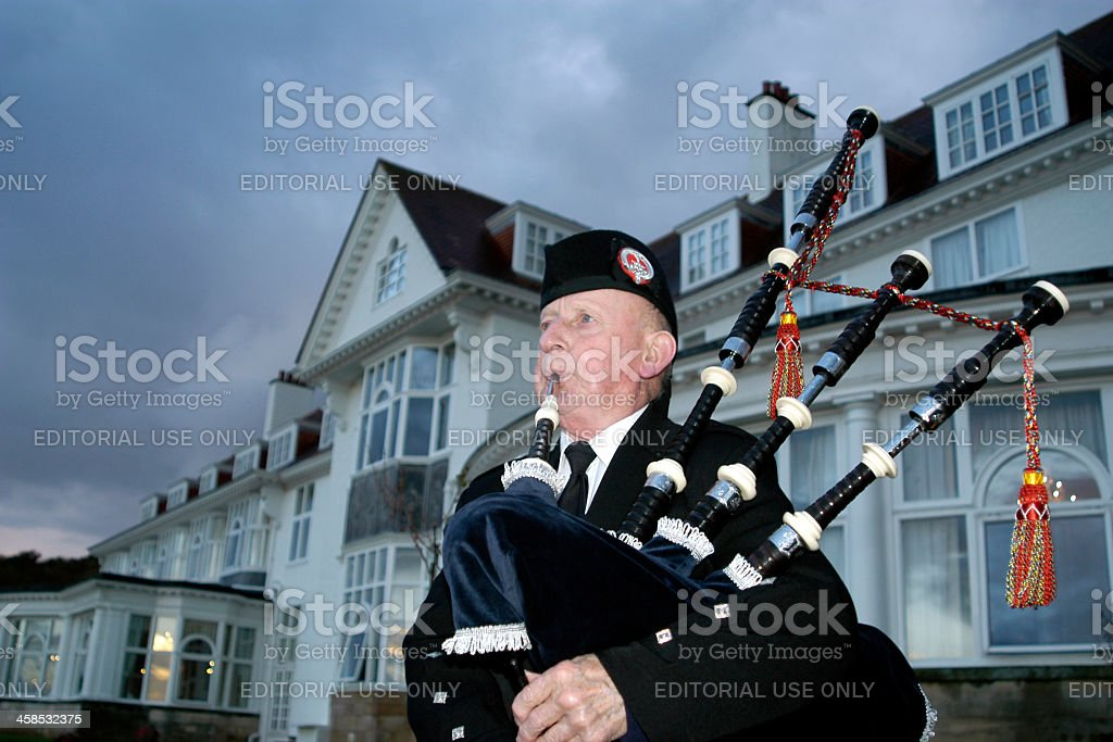 Bagpiper playing the bagpipes at Turnberry Resort in Scotland stock photo