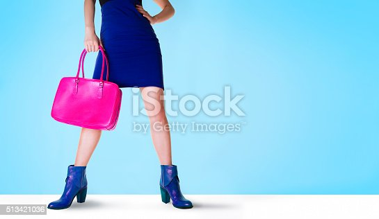 636803682 istock photo Bags and shoes. Beautiful legs woman. 513421036