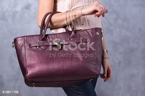 509923232istockphoto Bags fashion trends. Close up of gorgeous stylish bag 513811726