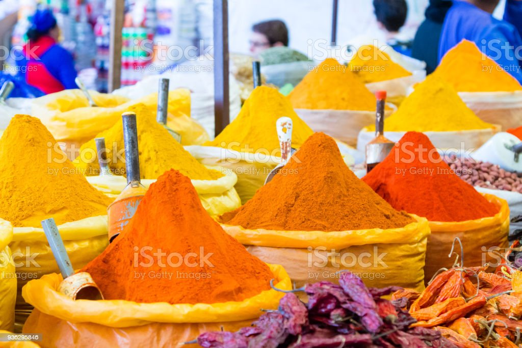Bags of colorful spices background stock photo