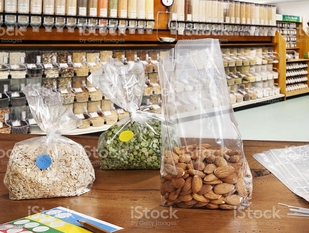Bags of nuts and lentils on shop counter stock photo