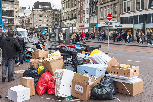 https://media.istockphoto.com/photos/bags-of-rubbish-and-garbage-along-a-central-street-and-canal-in-picture-id947290764?b=1&k=6&m=947290764&s=170667a&w=0&h=eTEnIYIOi7dFhEq-D8SS0ahU1bET1UIuQViIgry0SMk=