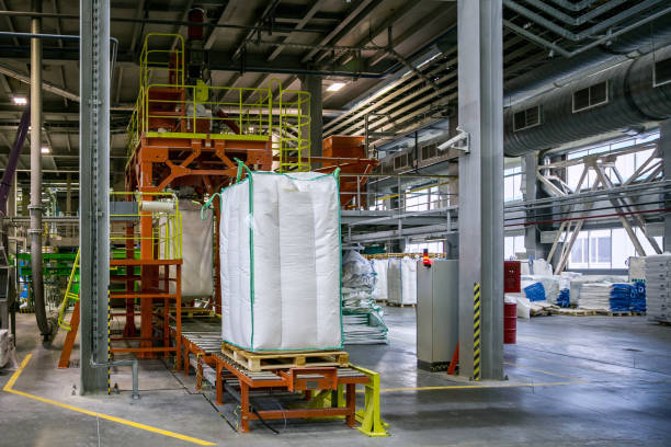 Bags with chemical production on conveyor at packing area at chemical factory stock photo