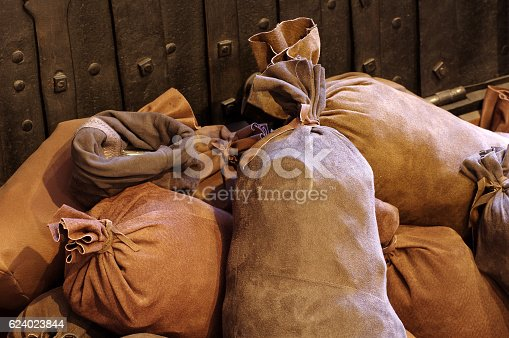 istock bags with coins 624023844