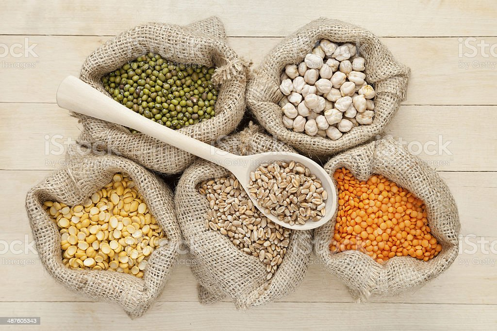 bags with red lentils, peas, wheat and green mung stock photo