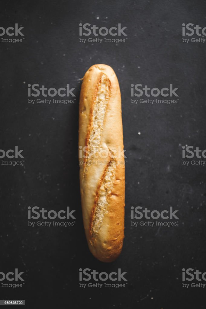 Baguette bread on black table stock photo