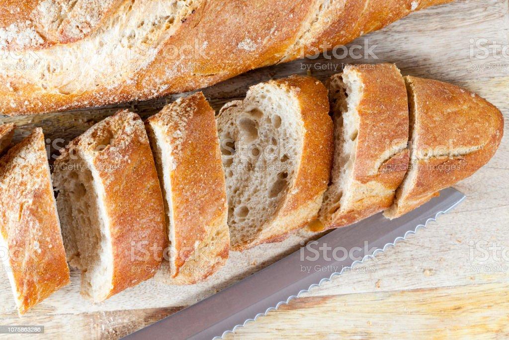 baguette cut into pieces stock photo
