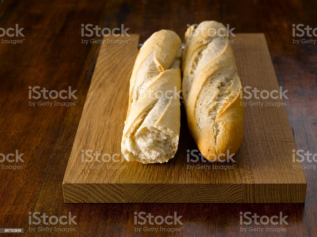 Baguette on Chopping Board royalty-free stock photo