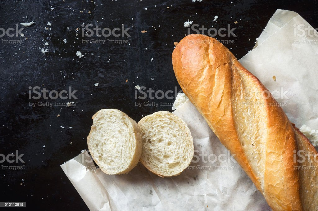 Baguette on paper stock photo