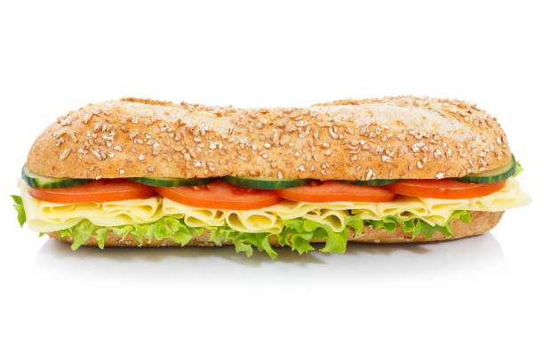 Baguette sub sandwich whole grains with cheese lateral isolated Baguette sub sandwich whole grains with cheese lateral isolated on a white background submarine sandwich stock pictures, royalty-free photos & images