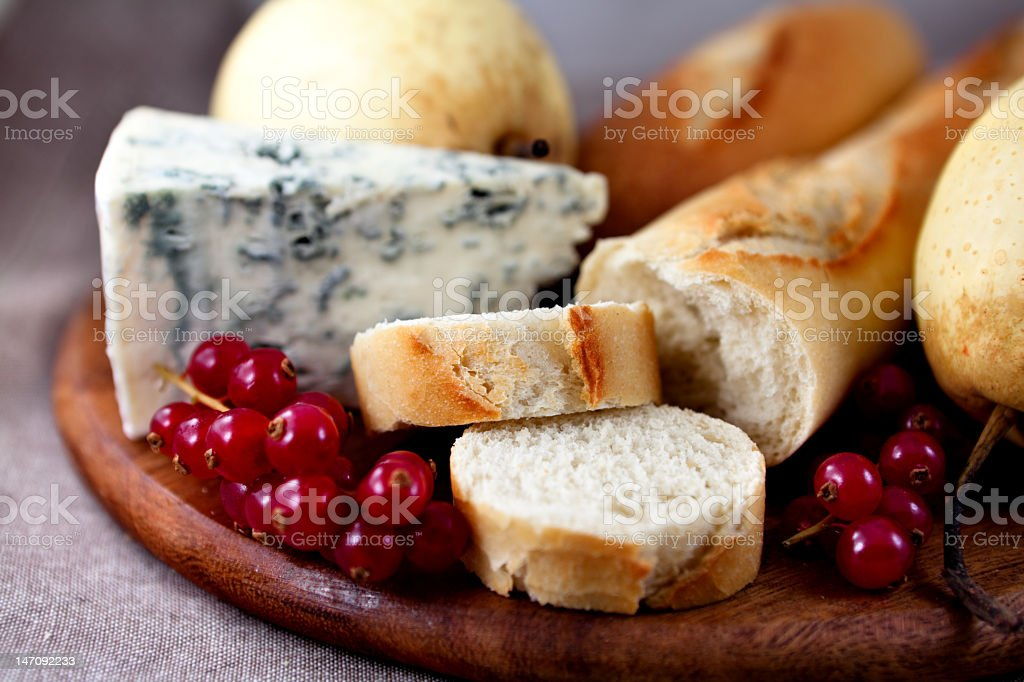 Baguette with blue cheese and fruits stock photo