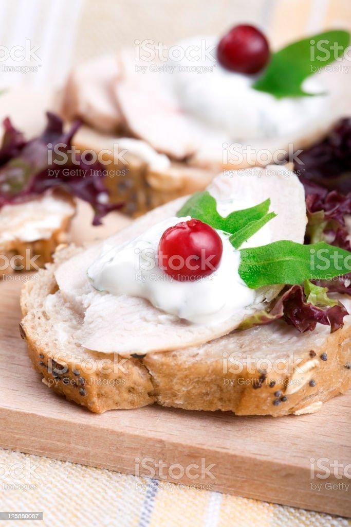 Baguette with chicken and arugula yogurt stock photo