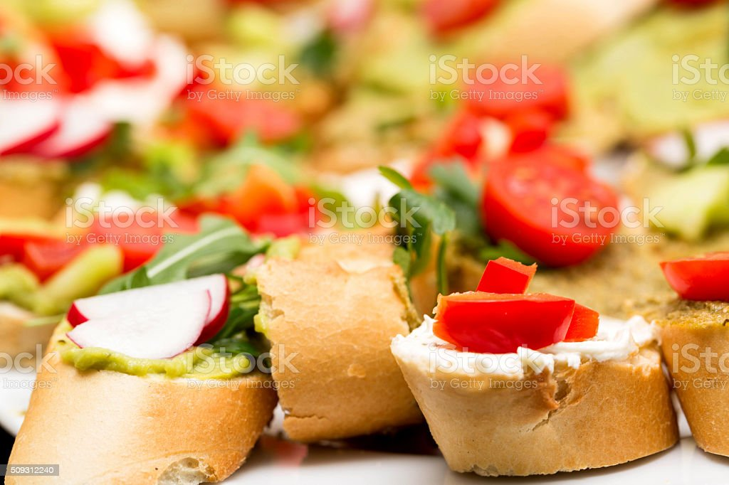 baguette with pesto and vegetables with blurred depth of field stock photo