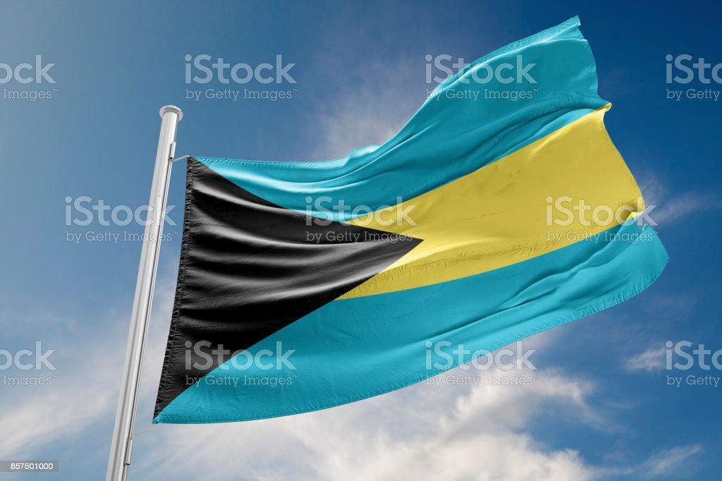 Bahamas Flag is Waving Against Blue Sky stock photo