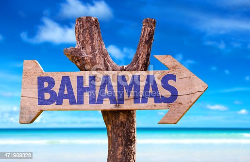 istock Bahamas sign with beach background 471969328