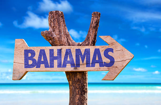 Bahamas sign with beach background stock photo