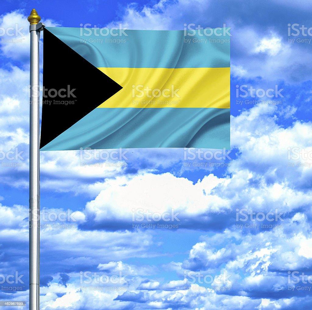 Bahamas waving flag against blue sky stock photo