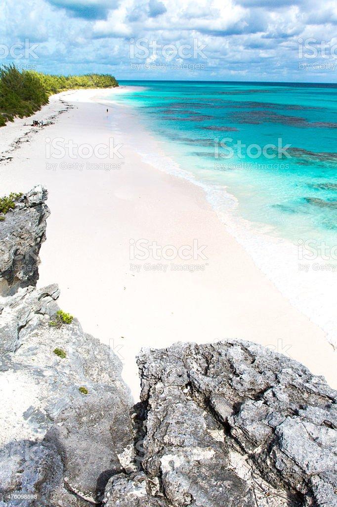 Bahamas white sand beach vertical stock photo