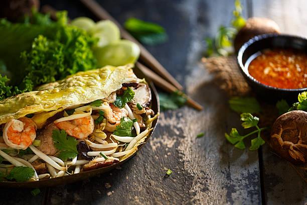 bahn xeo bahn xeo, vietnamese crepe vietnamese culture stock pictures, royalty-free photos & images