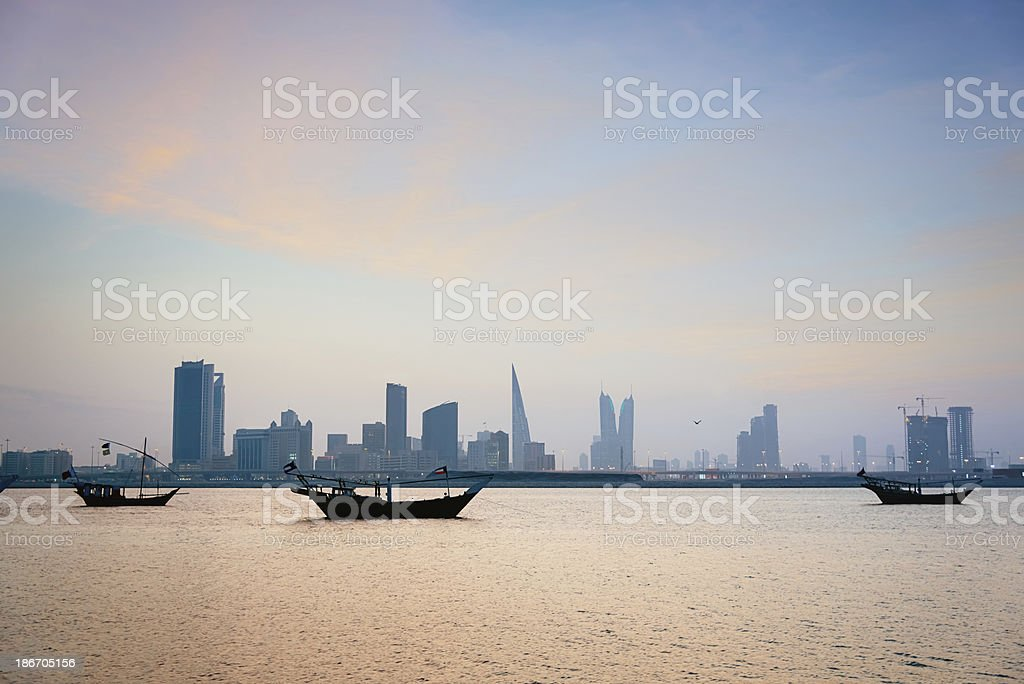 Bahrain Manama,Modern Skyline and Traditional Dhows stock photo