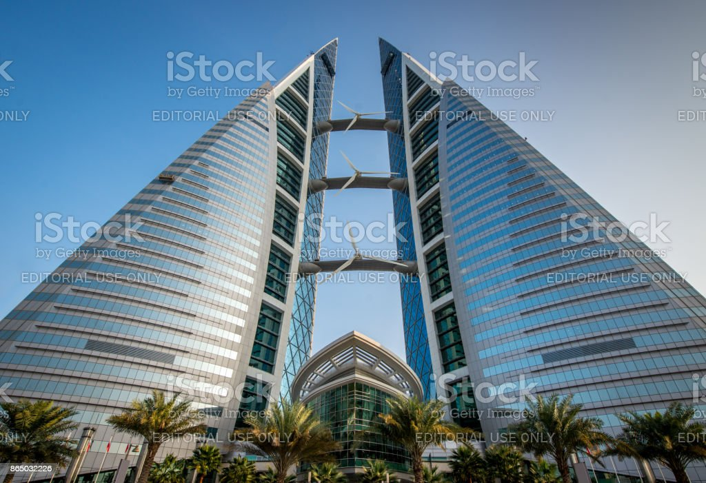 Bahrain WTC World Trade Center Building Manama Manama, Bahrain - 23rd December 2015: Streetview to the modern Bahrain World Trade Center. The well-known WTC Bahrain produces it`s electrical power with built-in wind turbines. Manama, Bahrain, Middle East Arab Culture Stock Photo