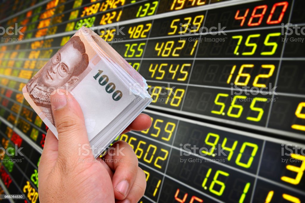 1000 baht banknotes on stock market background. royalty-free stock photo