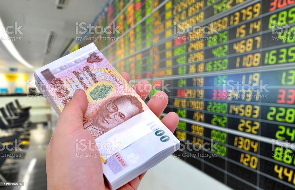 1000 baht banknotes on stock market background. zbiór zdjęć royalty-free